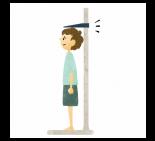 身長を測定する猫背の男の子