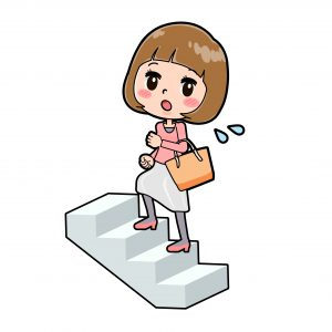 階段を上る妊婦さん