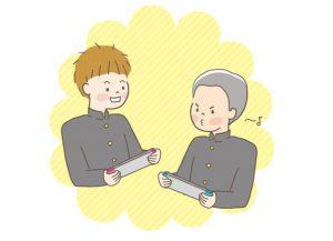 ゲーム機で遊ぶ男子中学生